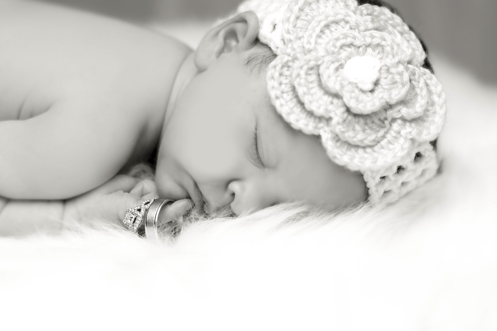 Newborn photography in Black and White with Wedding Rings and Flower Headband | Kropp Photography