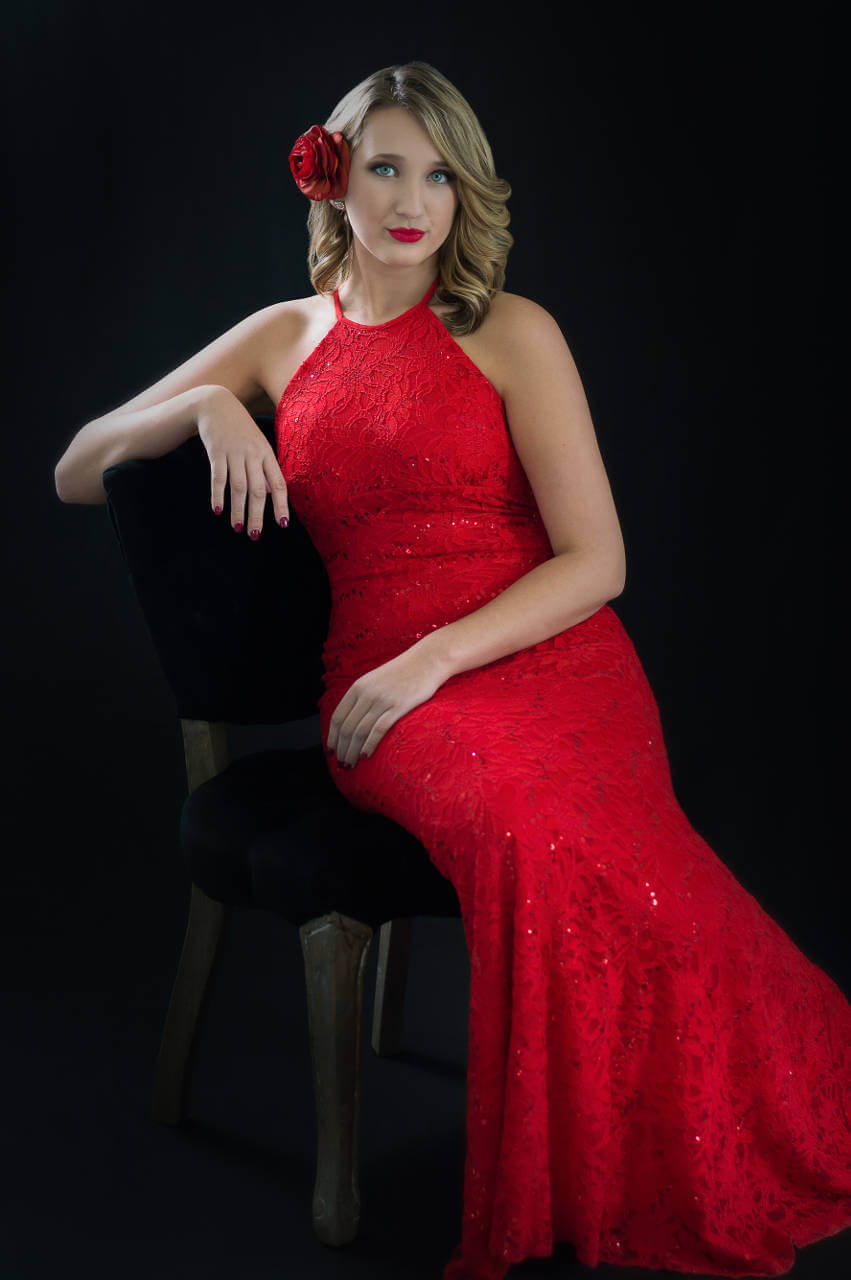 Senior pictures of high school girl in gorgeous red formal gown in front of black backdrop | Kropp Photography - Senior Pictures Portfolio