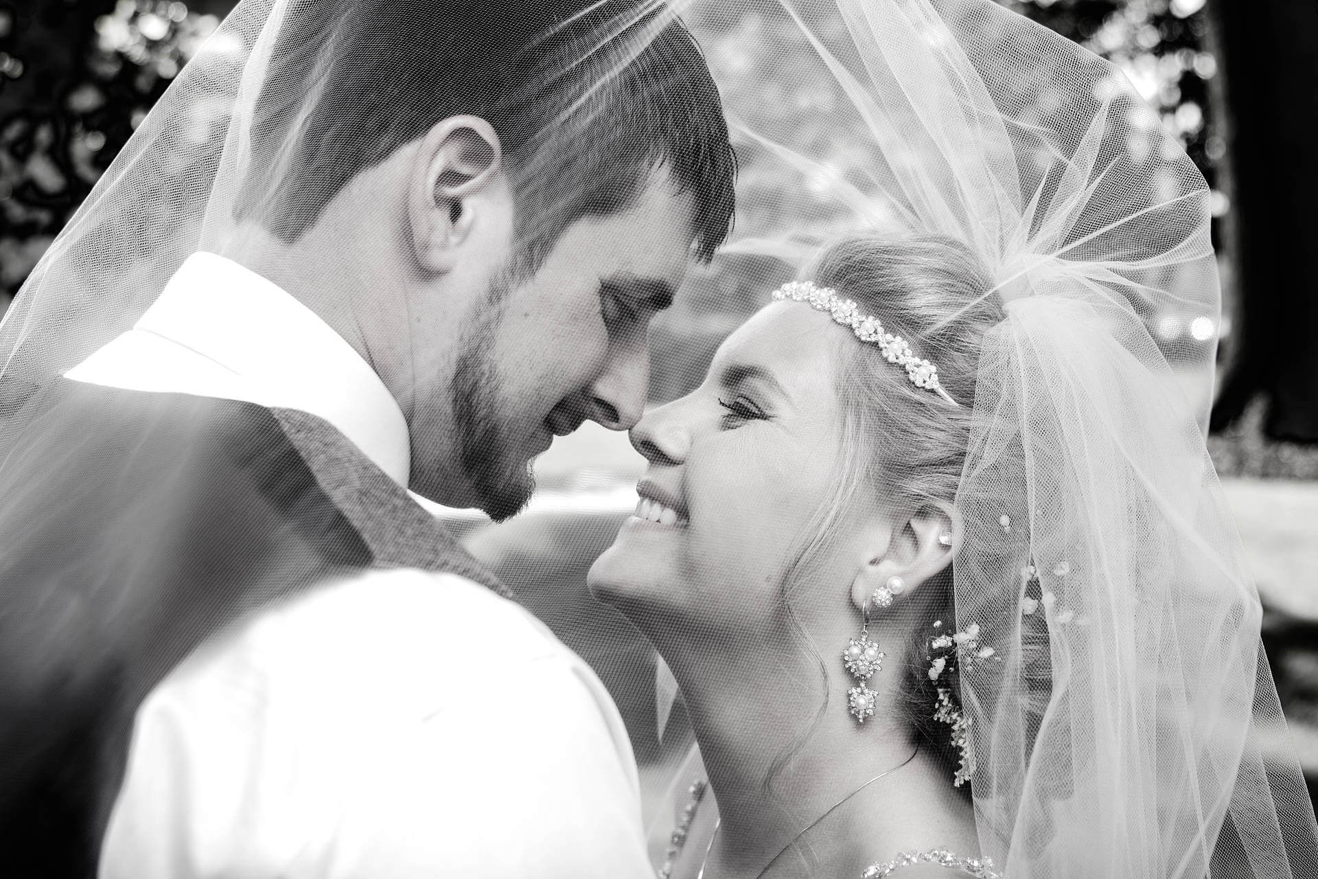 Happy Bride Smiling Under Her Veil   Kropp Photography - Wedding Photography Portfolio