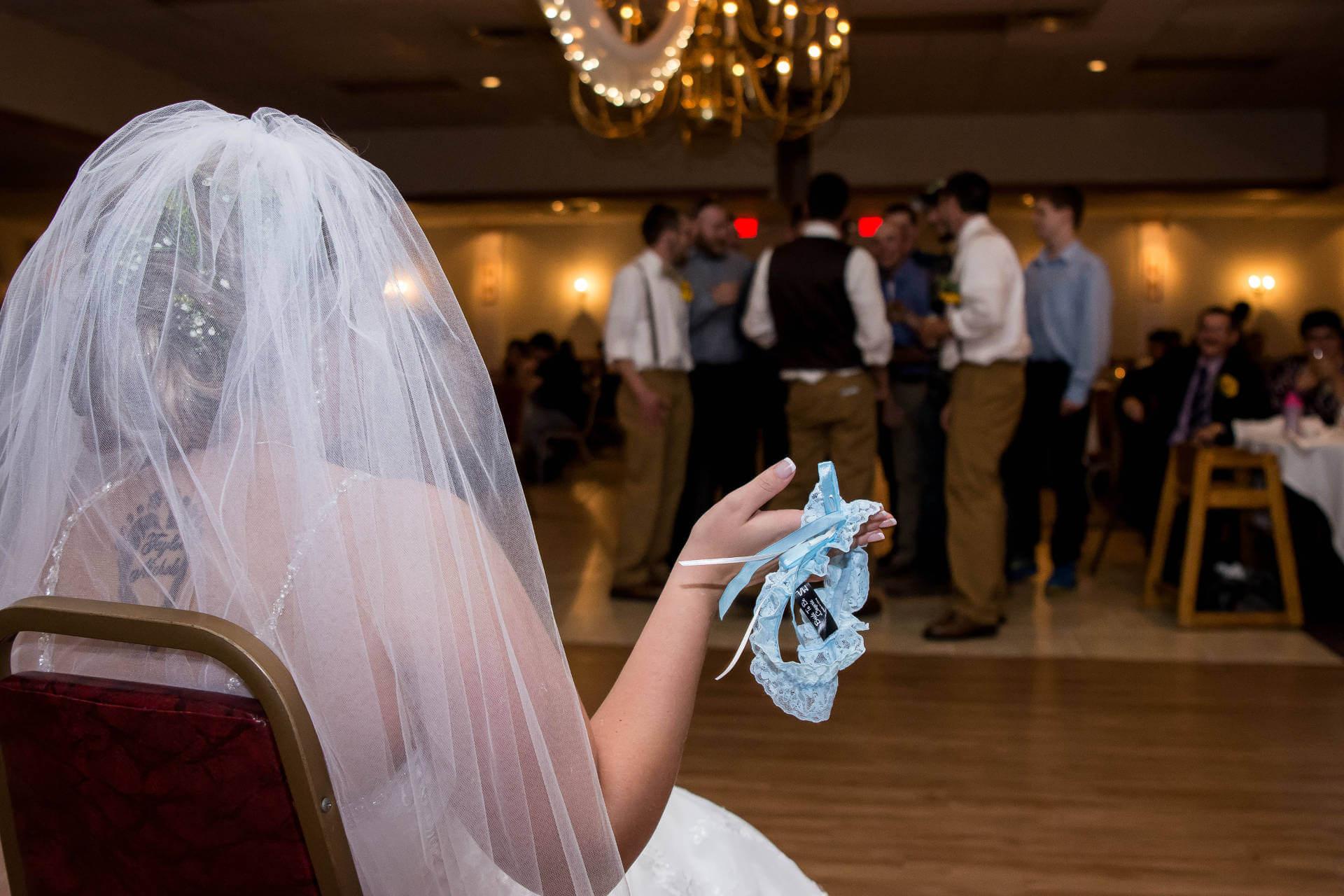 Bride ready for the garter toss   Kropp Photography - Wedding Photography Portfolio