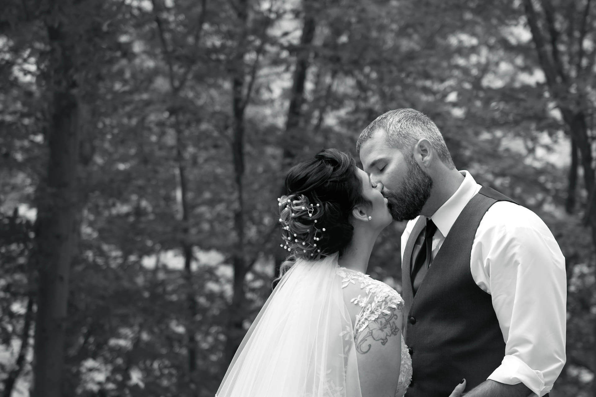 Kissing Husband and Wife in B&W   Kropp Photography - Wedding Photography Portfolio