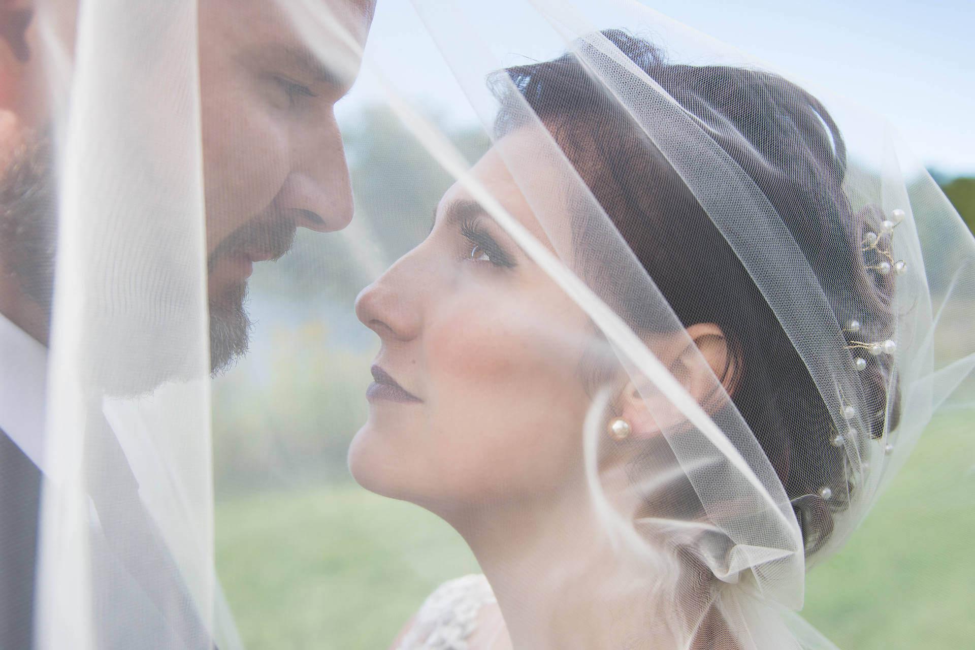 Intense Look Between Bride and Groom Under Veil   Kropp Photography - Wedding Photography Portfolio