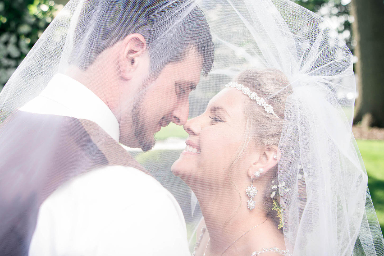 Ecstatic Bride Smiling at Her New Husband Face to Face Under Her Veil at McKinley Memorial Library | Kropp Photography - Youngstown Wedding Photographers