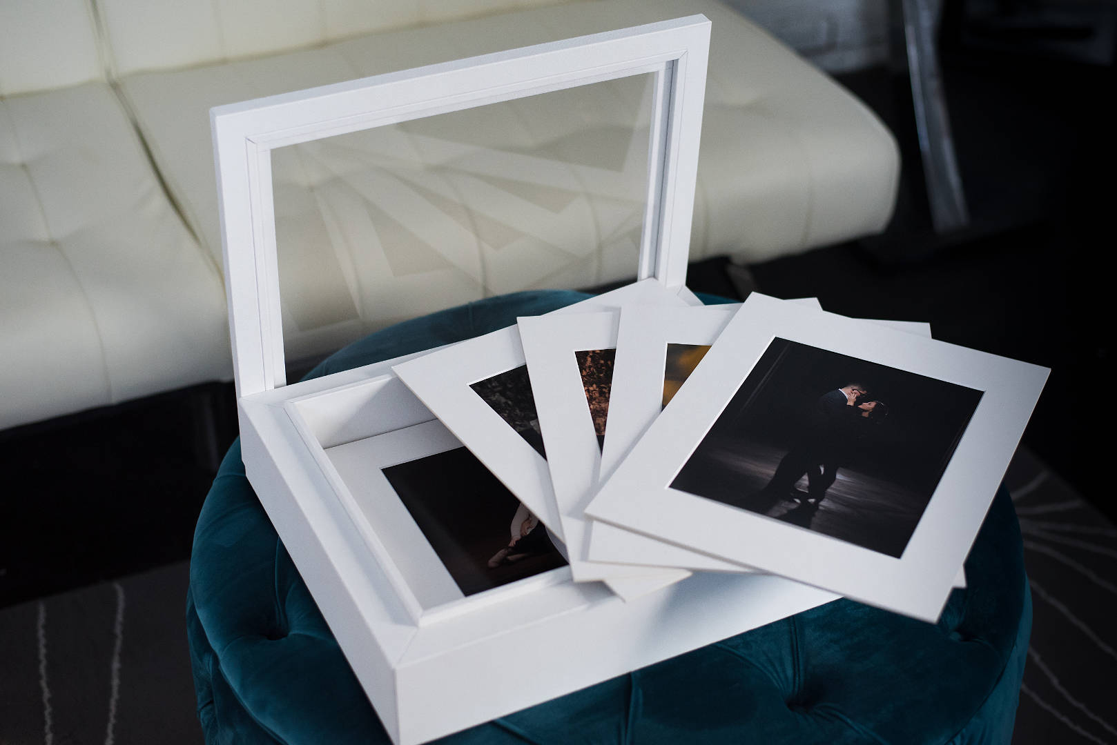white Italian leather folio display box with images in white mats   Kropp Photography
