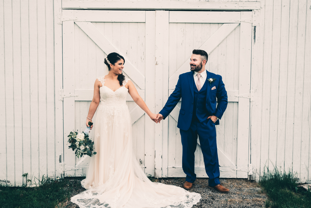 David + Maria | Wedding at The Place At 534 | Bride and Groom in Front of Barn Doors