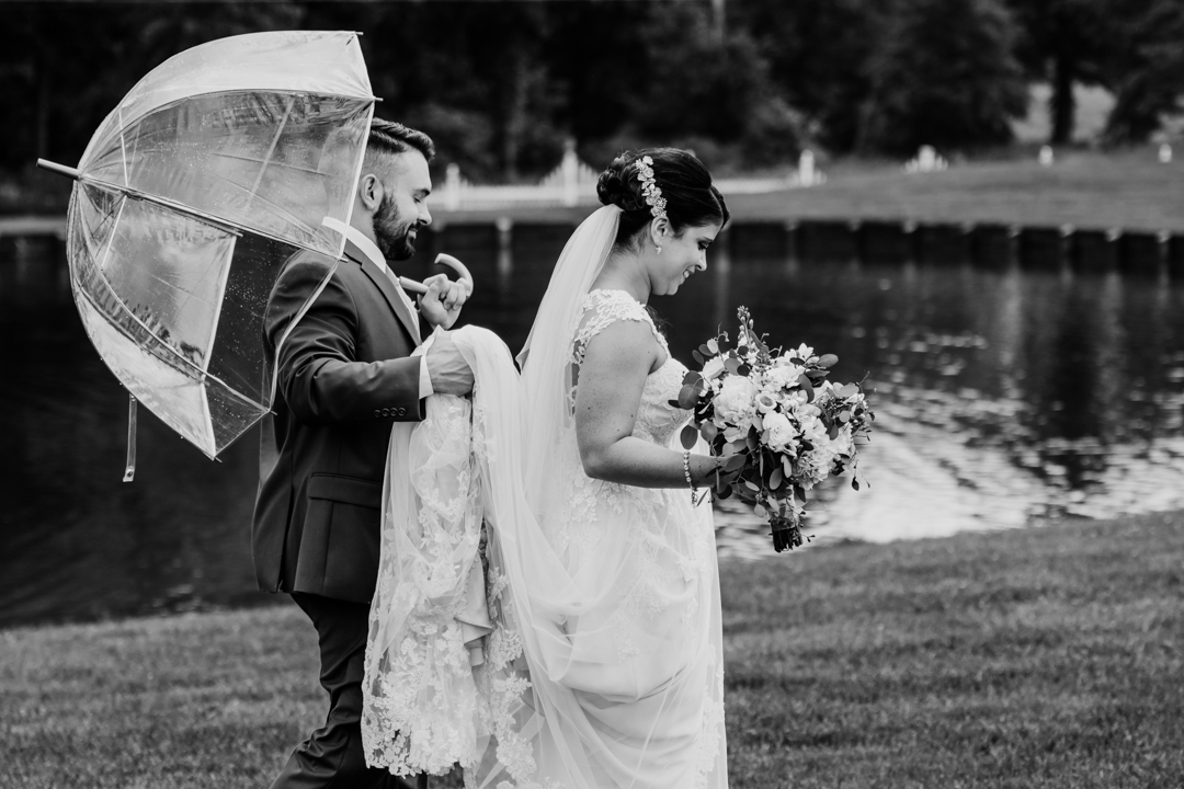 David + Maria | Wedding at The Place At 534 | Bride and Groom on Wedding Day with Bubble Umbrella Rain