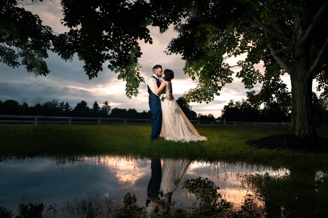 David + Maria | Wedding at The Place At 534 | Bride and Groom at Sunset with Reflection in Water