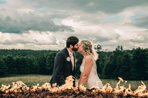 Bride and Groom Kissing in Front of Fire at Bella Amore on Enchanted Acres | Kropp Photography - Youngstown Wedding Photographers