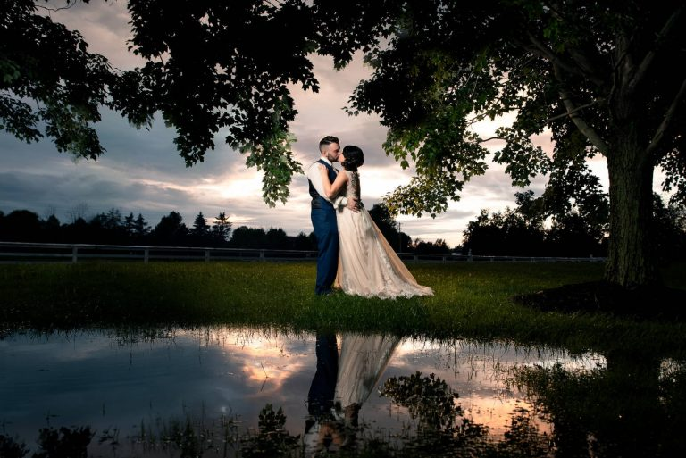 Bride and Groom Kissing During Sunset With Reflection In Puddle At The Place At 534 | by Kropp Photography - Cleveland Wedding Photographers