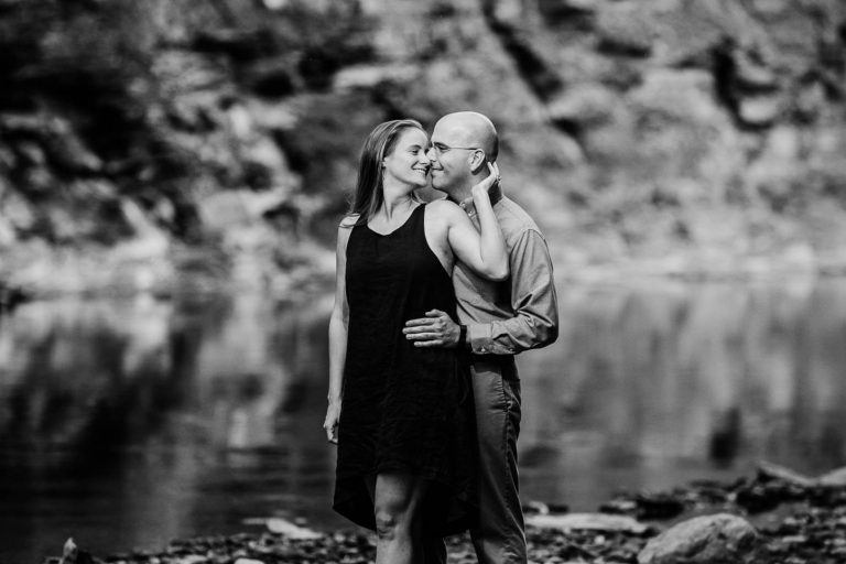 Lara + Karl | Black and White of Over the Shoulder Kiss | Rocky River Reservation Engagement Session