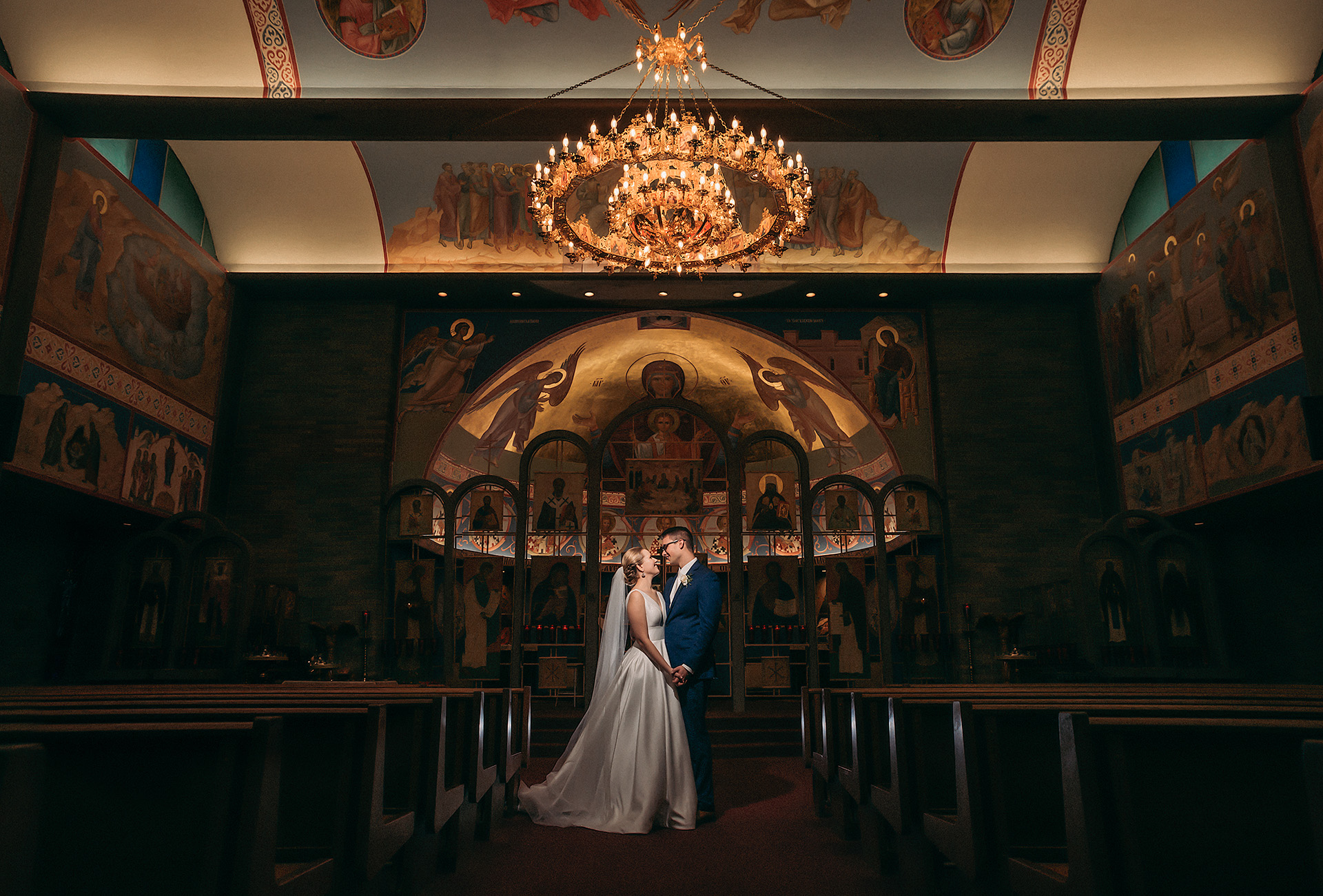 Orthodox Wedding Ceremony with Bride and Groom Under Stunning Gold Chandelier | by Kropp Photography