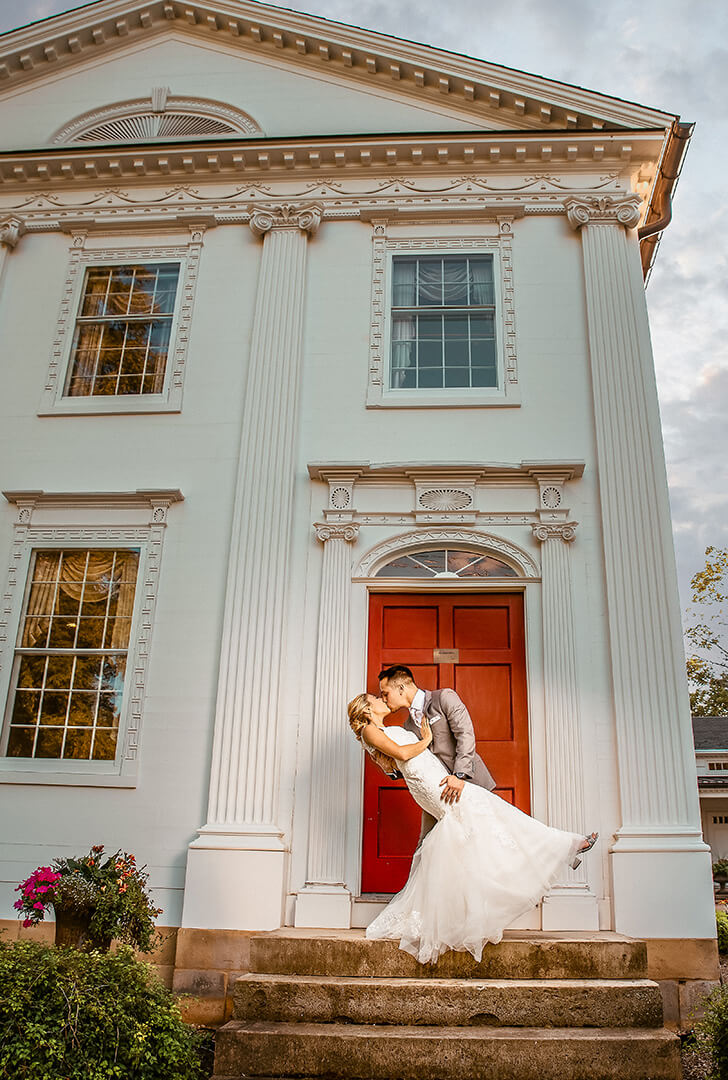 Becky and Dylan in front of the red door at Peter Allen Inn