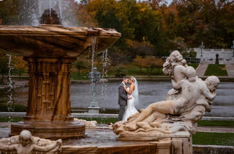 New Bride and Groom Embracing by Fountain at Cleveland Museum of Art and Wade Lagoon | by Kropp Photography
